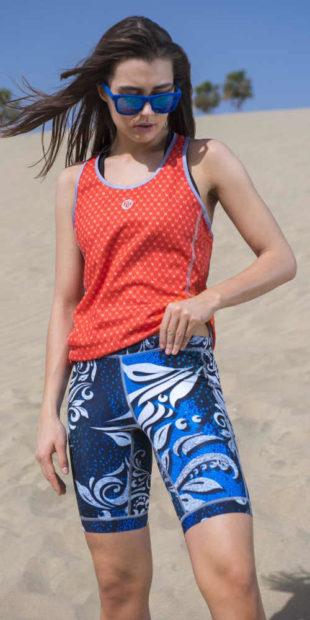 Běžecké capri legíny se silikonovým proužkem v lemu nohavice